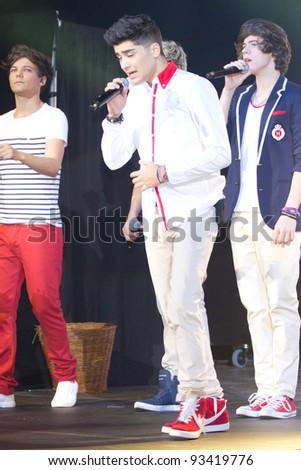 LONDON, UK - JANUARY 23: One Direction Play the HMV Apollo in London on the January 23, 2012 in London, UK - stock photo