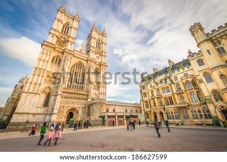 LONDON, UK - JANUARY 27: Sunset illuminating the golden stonework towers of Westminster Abbey in central London on January 27, 2013 - stock photo