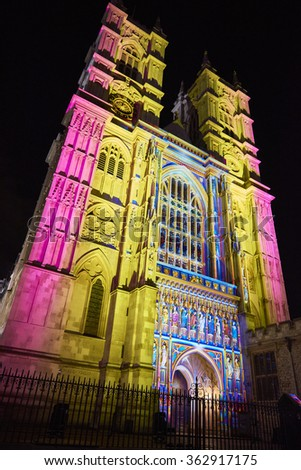 LONDON, UK - JANUARY 14: The Light of the Spirit installation, by Patrice Warrener, projected on the facade of Westminster Abbey as part of the Lumiere London. January 14, 2016 in London. - stock photo