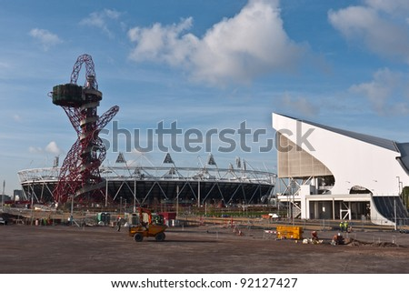 LONDON, UK -JANUARY 6:The Orbit Tower, Aquatic Centre and Olympic Stadium  being prepared for The 2012 Olympic Games which will be held in the city of London, June 5, 2010, London, UK - stock photo