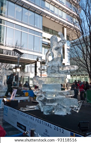 LONDON, UK- JANUARY 14: The Swedish ice sculpture under construction at the London Ice Sculpting Festival. The Annual festival was held in Canary Wharf, January 14, 2012 in London UK.