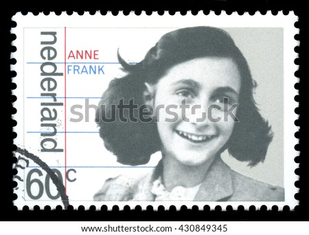 London, UK, January 15 2012 - Vintage 1980 Netherlands cancelled postage stamp  showing a portrait image of  Anne Frank a victim of the Holocaust, later to become famous for her diary - stock photo