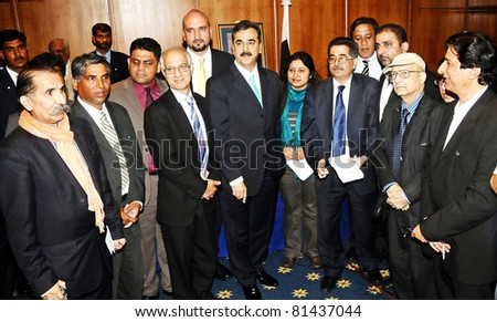 LONDON, UK - JUL 21: Prime Minister, Syed Yousuf Raza Gilani in a group photo with the Pakistani Journalists during meeting in London on Thursday, July 21, 2011.