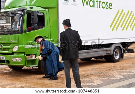 LONDON, UK-JULY 11: A close up of the Master Carman branding a year letter on a 2012 Waitrose Mercedes Benz Lorry, in the annual Cart Marking Ceremony. July 11, 2012 in London UK. - stock photo