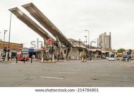 LONDON, UK - JULY 6, 2014: A cloudy morning at Vauxhall bus station, a landmark in the London Transport network. - stock photo
