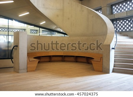 LONDON,UK - JULY 06, 2016: Architectural detail with concrete stairs and wooden sitting area in New Tate Gallery, London