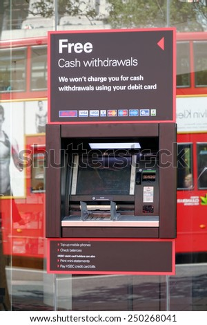 LONDON, UK - JULY 1, 2014: ATMs of HSBC Bank offering a free withdrawals for debit card owners in London, United Kingdom.  - stock photo