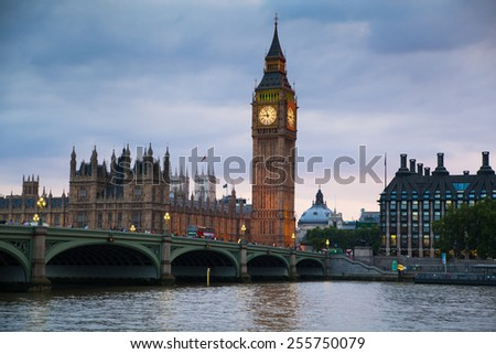 LONDON, UK - July 21, 2014: Big Ben and houses of Parliament. Thames embankment - stock photo