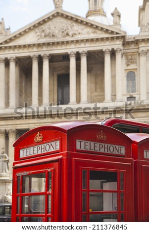 LONDON, UK - JULY 6, 2014: British red iconic phone box next to  St. Paul's cathedral