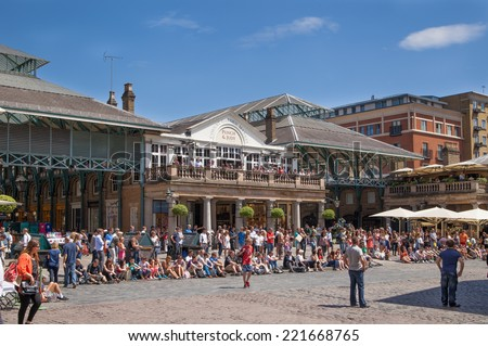 LONDON, UK - 22 JULY, 2014: Covent Garden market, one of the main tourist attractions in London, known as restaurants, pubs, market stalls, shops and public entertaining. - stock photo