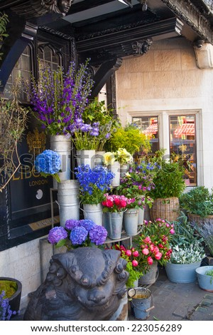 LONDON, UK - 22 JULY, 2014: Covent Garden market, one of the main tourist attractions in London. Flower shop - stock photo
