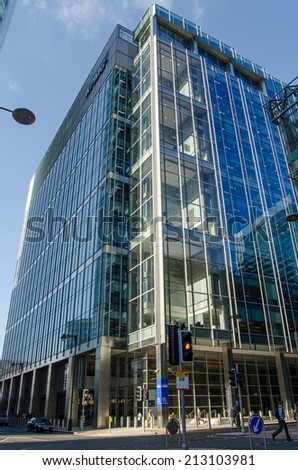 LONDON, UK - JULY 1, 2014:  Exterior of the modern office block housing the headquarters of accountants KPMG in London Docklands. - stock photo