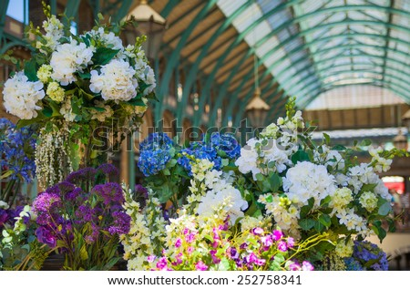 LONDON, UK - 22 JULY, 2014: Flower shop Covent Garden market, one of the main tourist attractions in London, known as restaurants, pubs, market stalls, shops and public entertaining. - stock photo