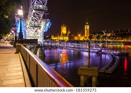 London, UK - July 22 2008 : Houses of Parliament with Big Ben, seen from below London Eye at dusk.  - stock photo
