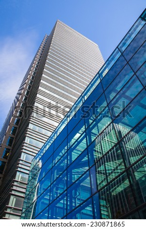 LONDON, UK - JULY 3, 2014: Modern glass architecture of Canary Wharf bunnies district - stock photo