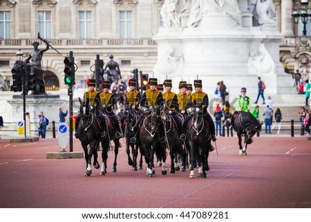 London, UK - JULY 19, 2016: Queen's Guards cavalry parade during traditional Changing of the Guards ceremony at Buckingham Palace. This is one of the most popular tourist attractions in London. - stock photo