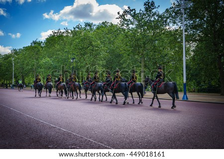 London, UK - JULY 19, 2016: Queen's Guards cavalry parade during traditional Changing of the Guards ceremony at Buckingham Palace. This is one of the most popular tourist attractions in London - stock photo