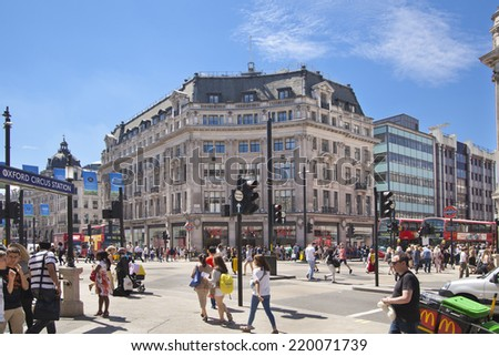LONDON, UK - JULY 29, 2014: Regent street in London, tourists and buses - stock photo