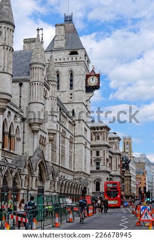 LONDON, UK -  JULY 1,  2014 : Royal courts of justice in London, commonly called the Law Courts, was built in the 1870 and were opened by Queen Victoria in December 1882. - stock photo