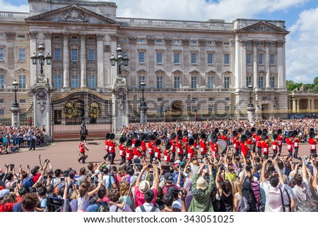 LONDON, UK - JULY 20, 2015: Royal Guards during traditional Changing of the Guards ceremony near Buckingham Palace. This ceremony is one of the most popular tourist attractions in London. - stock photo