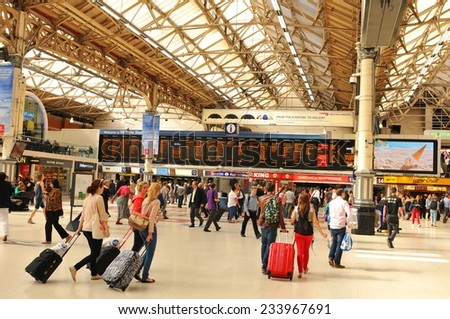 LONDON, UK - JULY 9, 2014: Rush hour in Victoria Station, London - stock photo