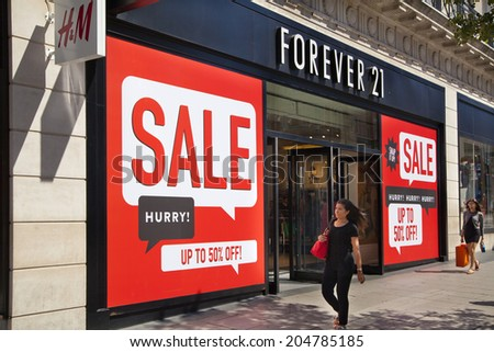 LONDON, UK - JULY 03, 2014: Sale sign on Oxford street shopping mail with famous fashion boutiques and super stors - stock photo