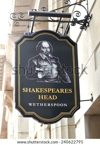 LONDON, UK - JULY 9, 2014: Sign of traditional English pub Shakespeare's Head Wetherspoon in central London - stock photo