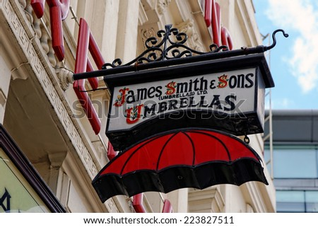LONDON, UK - JULY 1, 2014: The famous James Smith and Sons Umbrella shop sign on New Oxford street. Founded in 1830 it is a stunning reminder of the Victorian period.  - stock photo
