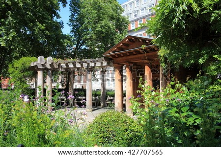 London, UK -  July 24, 2011: The Garden Memorial in Grosvenor Square, dedicated to the 67 British victims of the September 11 terrorism attack in New York - stock photo