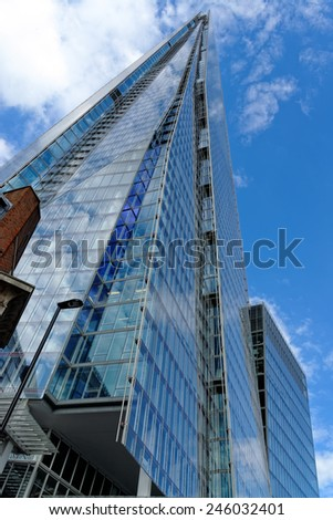 LONDON, UK - JULY 1, 2014: The Shard skyscraper designed by the Italian architect Renzo Piano has 87 storeys over a height of 1004 feet. The Shard is the tallest building in Europe.