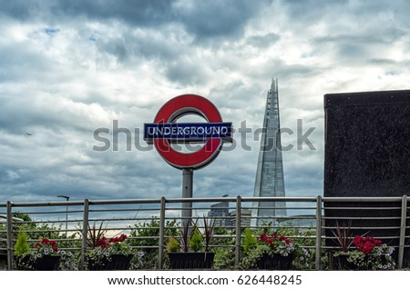 LONDON, UK - 16 JULY, 2016: Tower Hill underground station exit with The Shard scyscraper in background in London, United Kingdom.