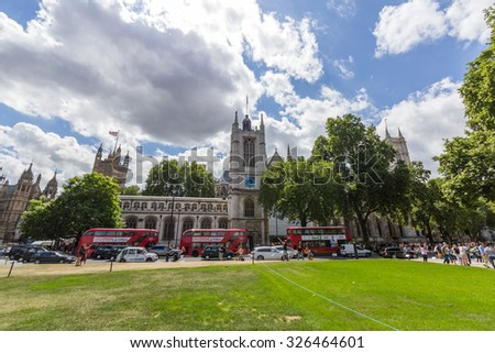 LONDON, UK - JULY 20, 2015: Westminster Abbey is located in the City of Westminster, London, next to the Palace of Westminster. It is formally titled the Collegiate Church of St Peter at Westminster. - stock photo