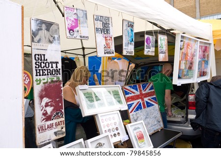 LONDON, UK- JUNE 19: Artist Swifty shows prints and art work on his stall at the Annual Art Car Boot Fair in London's East End on June 19, 2011 in London UK.