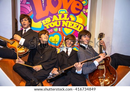 LONDON , UK - JUNE 7, 2015: Beatles wax figures in Madame Tussauds museum. It  is one of the main attractions for tourists - stock photo