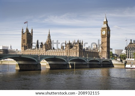 LONDON, UK - JUNE 24, 2014 - Big Ben and Houses of Parliament on Thames river - stock photo