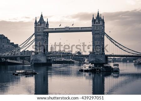 LONDON, UK - JUNE 19 2016: Black and white Tower Bridge in London people viewing it on 2016 RICOH Lord Mayor's Balloon Regatta. - stock photo