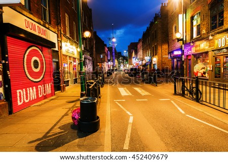 London, UK - June 16, 2016: Brick Lane in the London district Shoreditch at night. Shoreditch is a inner city district of London. It was one of the poorer districts but today very trendy.