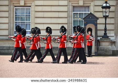 LONDON, UK - JUNE 12, 2014: British Royal guards perform the Changing of the Guard in Buckingham Palace  - stock photo