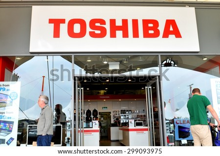London, UK - June 14, 2015: Detail of the entrance to a Toshiba store. Toshiba is a famous Japanese multinational corporation whose products and services include IT and communications equipment. - stock photo