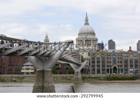 LONDON, UK - JUNE 23: Dome of Saint Paul's cathedral with Millennium Bridge in the foreground. June 23, 2015 in London. - stock photo