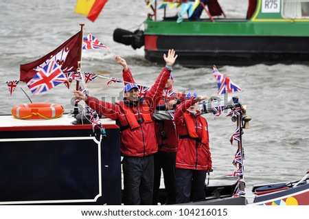 LONDON, UK - JUNE 3: Hundreds of boats muster on the river Thames in Putney for the Thames Diamond Jubilee Pageant to celebrate the Queen's Diamond Jubilee on June 3, 2012 in London. - stock photo