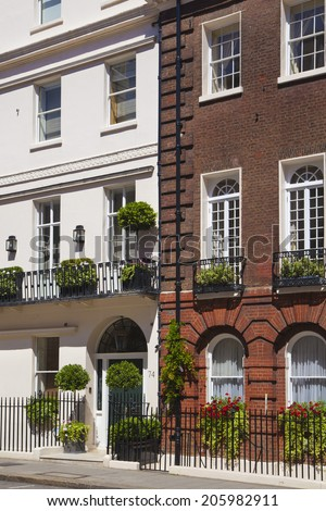LONDON, UK - JUNE 3, 2014: Luxury public house in Mayfair, decorated with flower baskets