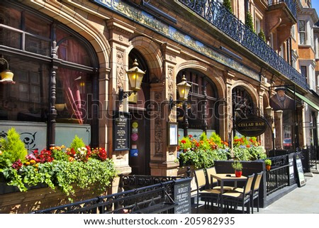 LONDON, UK - JUNE 3, 2014: Luxury public house in Mayfair, decorated with flower baskets - stock photo