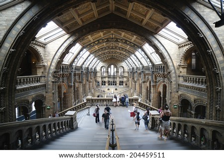 LONDON, UK - JUNE 20; Natural History Museum interior in London, United Kingdom - June 20, 2014; Famous London Natural History Museum big hall interior with tourists visitors - stock photo