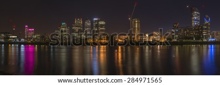 LONDON, UK - JUNE 06, 2015: Night view of Canary Wharf, a major business district located in London, UK. It's a home to the headquarters of numerous major banks and other professional service firms