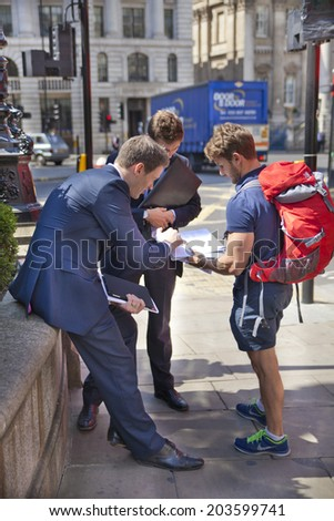 LONDON, UK - JUNE 30, 2014: Office people and tourist.  Bank of England. Square and underground station - stock photo