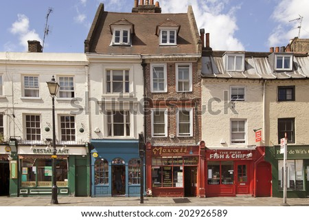 LONDON, UK - JUNE 17, 2014: Old street Greenwich view with small shops - stock photo