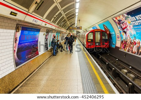 London, UK - June 19, 2016: platform of an underground station with unidentified people in London. The London Underground is the oldest underground of the world. - stock photo