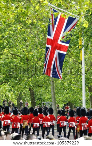 LONDON, UK - JUNE 16: Queen's guards during Trooping the Colour ceremony on the Mall and at Buckingham Palace, on June 16, 2012 in London. - stock photo