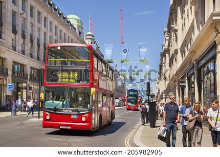 LONDON, UK - JUNE 3, 2014: Regent street in Mayfair, busy with tourists and public transport  - stock photo
